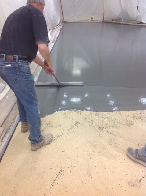 spreading concrete stain