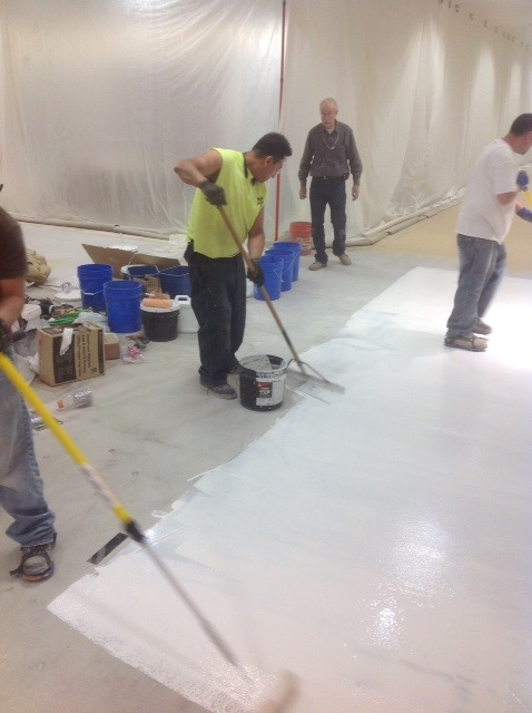 pouring and spreading the overlay