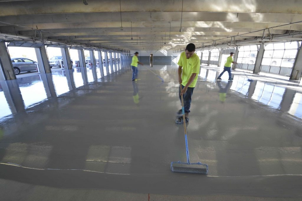 texas-motor-speedway-applying-spartacote-concrete-coatings-garage-areas